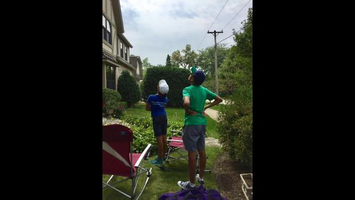 Our kids watching the eclipse in our front yard. Glencoe, Illinois. (Submitted by: Fraline Allgaier)