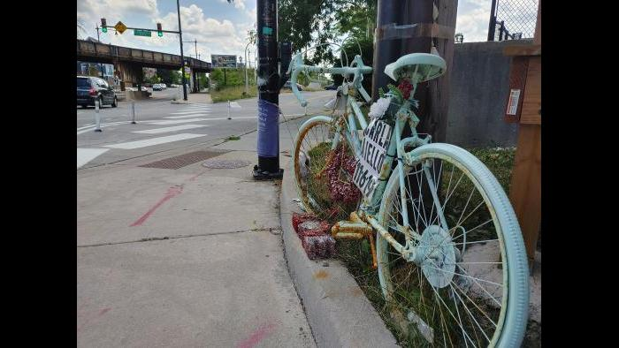 A ghost bike honors Carla Aiello, a cyclist killed in a traffic accident near Kilbourn and Milwaukee avenues in November 2019 at Kilbourn and Milwaukee avenues. (Erica Gunderson / WTTW News)