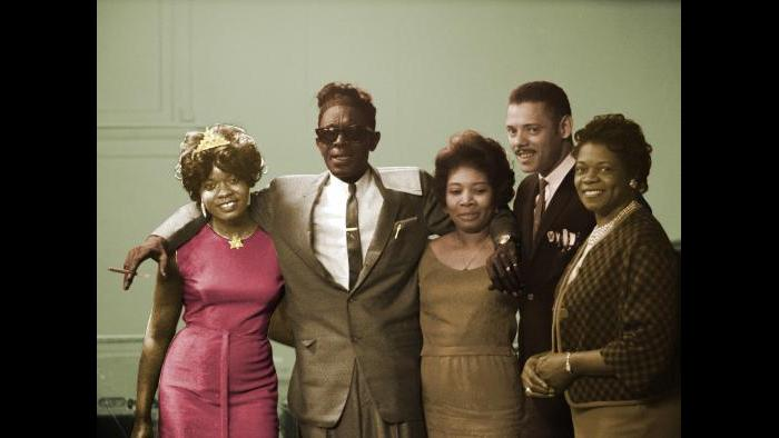 From left: Koko Taylor with Lightnin' Hopkins and unidentified individuals at Western Hall in Chicago, April 23, 1965. Raeburn Flerlage image, colorized.