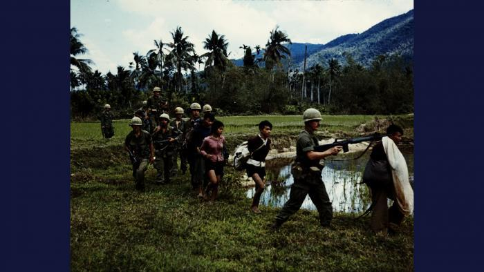 Captured, 1967. Members of U.S. Army 1st Cavalry Division return to base camp in the An Lao Valley with Viet Cong prisoners. Photo by Specialist 5 Robert C. Lafoon, U.S. Army.