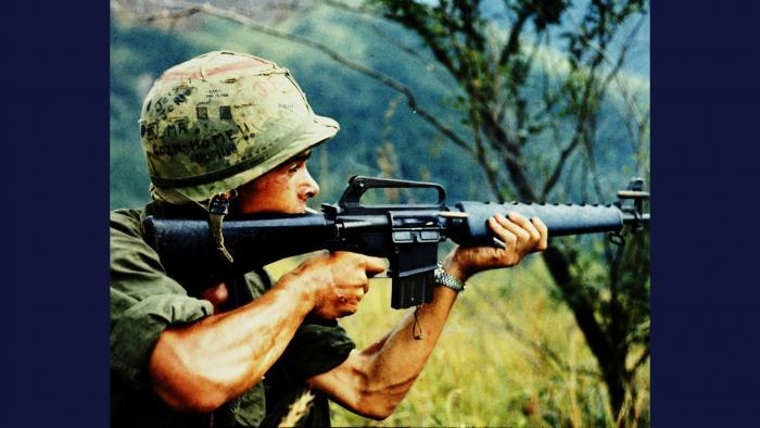 Recon by Fire, 1967. A member of the U.S. Army 101st Airborne Brigade in Quảng Ngãi Province uses his M16 rifle to conduct reconnaissance by fire. Photo by Specialist 5 Robert C. Lafoon, U.S. Army.