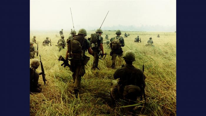 Chasin' Charlie, 1966. Members of the U.S. Army 101st Airborne Brigade prepare to move across a rice field near Tuy Hòa in pursuit of the enemy.Photo by Specialist 5 Robert C. Lafoon, U.S. Army.