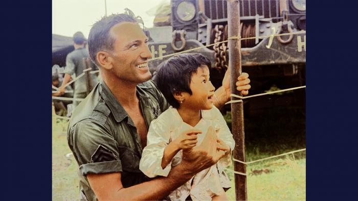 Connecting, 1967. Soldiers of the U.S. Army 1st Infantry Division provide food and medical attention to local villagers near Thuận Giao. Photo by Specialist 5 Robert C. Lafoon, U.S. Army.