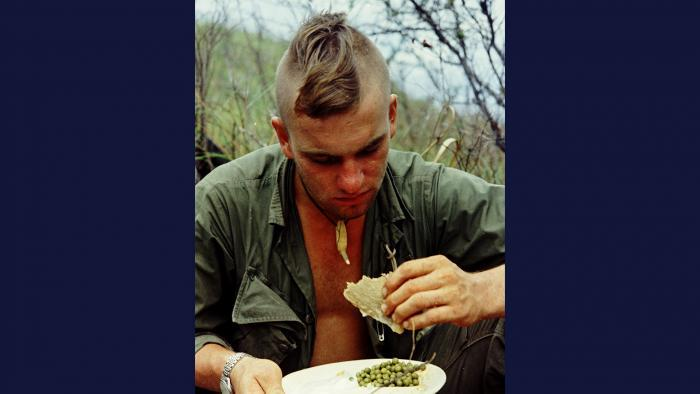 Home Cookin' 1967. A member of the U.S. Army 101st Airborne Division eats his first hot meal in five days after operating in the Quảng Ngãi Province. Photo by Specialist 5 Robert C. Lafoon, U.S. Army.