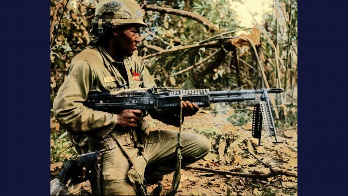 Pig, 1967. A member of the U.S. Army 25th Infantry Division fires his M60 machine gun at a tree line in the Filhol Rubber Plantation near Củ Chi.