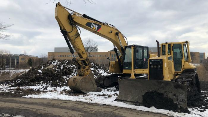 The earth-moving portion of the project in Legion Park is nearly completed. Soil is being trucked to Big Marsh park on Chicago's South Side, where it's being used to remediate land contaminated by industry. (Patty Wetli / WTTW News)