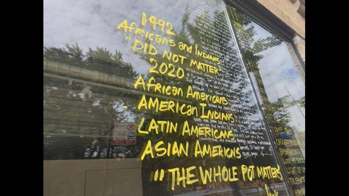 "The installation ""Letters to the World Toward the Eradication of Racism"" in progress. (Erica Gunderson / WTTW News)"