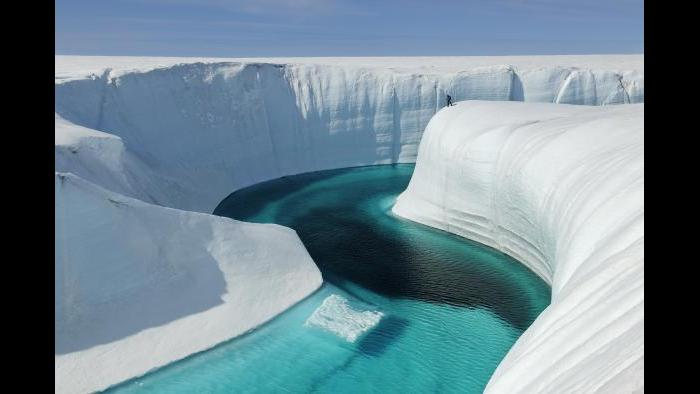 A meltwater river formed by glacier melt in Greenland. (James Balog / Museum of Science and Industry)