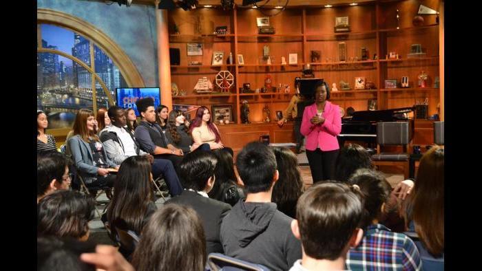 Chicago Tonight correspondent Brandis Friedman talks with Mikva Challenge students before the Monday forum. (Kristen Thometz / Chicago Tonight)