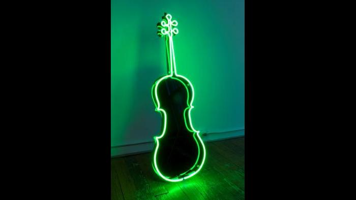 Charlotte Moorman. Neon Cello, ca. 1989. Plexiglass, neon, and electrical parts, 48 1/2 × 16 in. Courtesy of Emily Harvey Foundation. (Photograph by João Simões. Courtesy of Emily Harvey Foundation.)