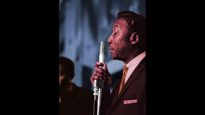 Muddy Waters performing at Pepper's Lounge in Chicago, 43rd and Vincennes, 1961. Raeburn Flerlage image, colorized.