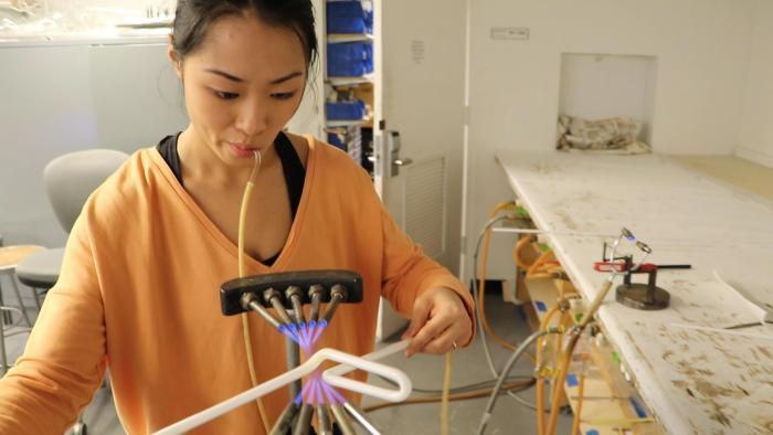 Neon artist Lisa Chen bends a glass tube at the School of the Art Institute of Chicago's Light Lab.