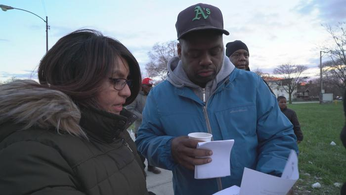 Case manager Mirella Rodriguez distributes housing applications. (Chicago Tonight)