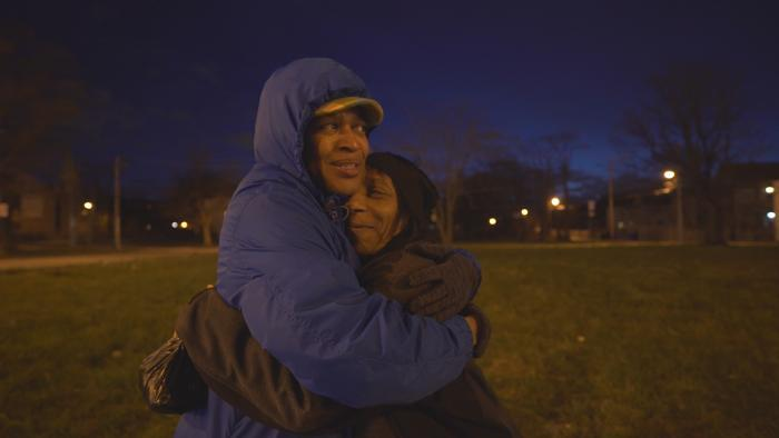 Rev.  Faith Miller embraces a woman in the Back of the Yards neighborhood. (Chicago Tonight)