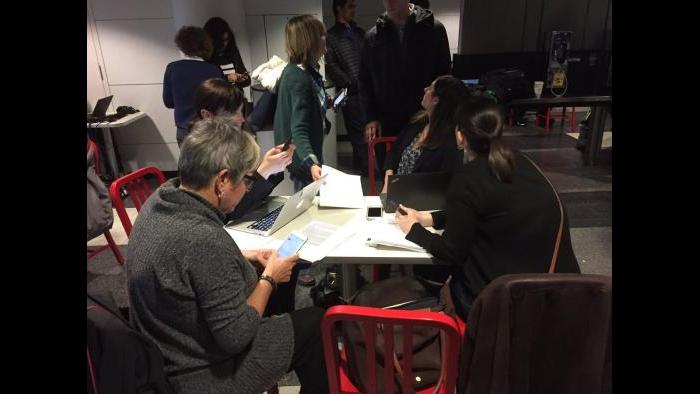 Immigration lawyers fill out G-28 forms that allow them to intervene on behalf of those detained at O'Hare airport. (Paris Schutz / Chicago Tonight)