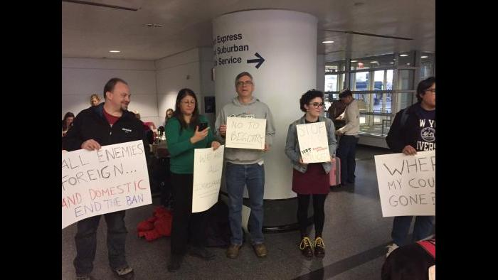 Protesters gather at O'Hare airport Saturday afternoon. (Paris Schutz / Chicago Tonight)