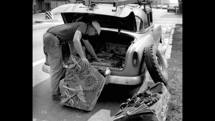 Richard Nickel picks up terra-cotta from the Hammond Library (44 N. Ashland Ave.) on Chicago's West Side in 1963. (Courtesy the Richard Nickel Archive/ Ryerson and Burnham Archives/ The Art Institute of Chicago)