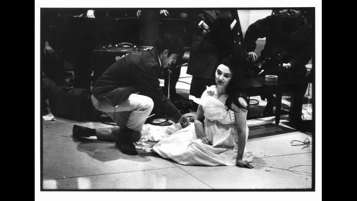 Peter Moore. Charlotte Moorman performs Yoko Ono's Cut Piece, New York University, New York City, December 16, 1967. (Photograph © Barbara Moore/Licensed by VAGA, NY.)