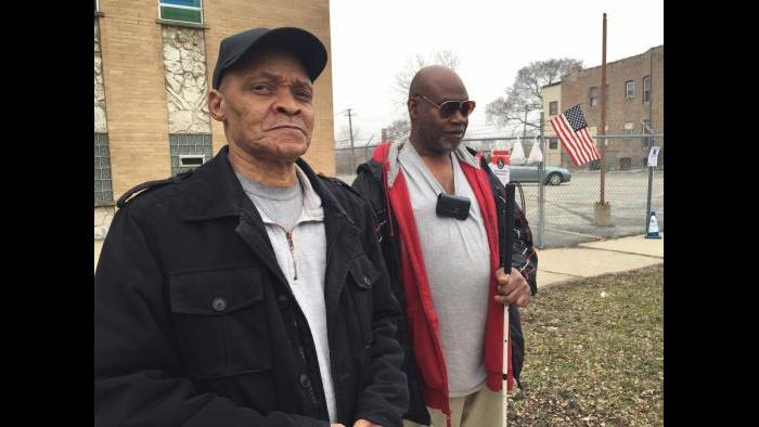 Perry, left, and Ronald Boyd at their 20th Ward polling place on Tuesday. (Eddie Arruza)