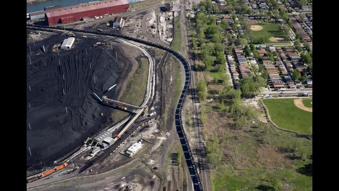 Petcoke-laden train snaking through the East Side neighborhood, 2015.(Terry Evans / Courtesy of Museum of Contemporary Photography)