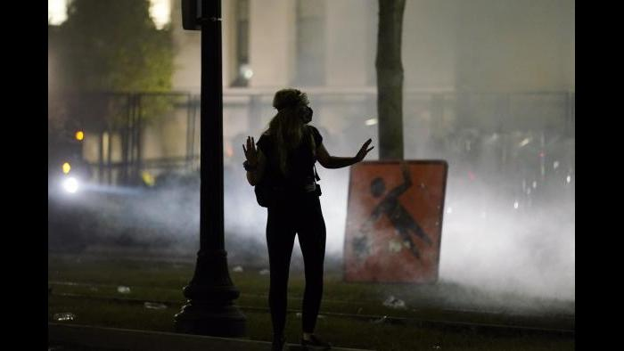 A protester gestures at authorities Tuesday, Aug. 25, 2020 in Kenosha, Wis. Anger over the Sunday shooting of Jacob Blake, a Black man, by police spilled into the streets for a third night. (AP Photo / Morry Gash)