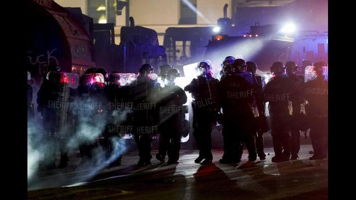 Authorities disperse protesters out of a park Tuesday, Aug. 25, 2020 in Kenosha, Wis. Anger over the Sunday shooting of Jacob Blake, a Black man, by police spilled into the streets for a third night. (AP Photo / Morry Gash)