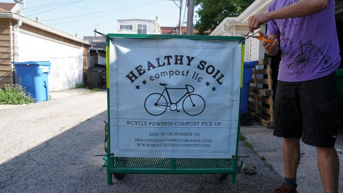 Prepping the Healthy Soil Compost trailer. (Alexandra Silets / Chicago Tonight)