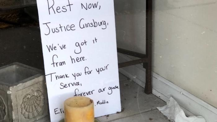 A small memorial for Ruth Bader Ginsburg, outside the Edgewater offices of Cedille Records, owned by the son of the late Supreme Court justice. (Patty Wetli / WTTW News)