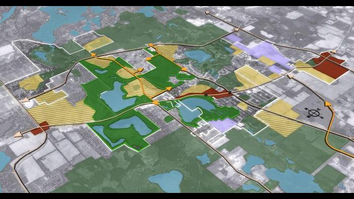 Aerial rendering of key recommendations in the Lakemoor the future land use plan, including conservation neighborhood design, mixed-use town center, and commercial/industrial development.