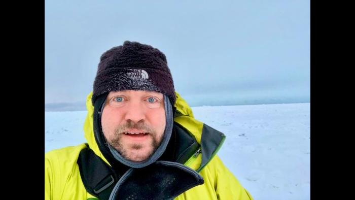 Scott Collis stands on ice sheet in Utqiagvik, Alaska, where temperatures can reach between minus 40 to minus 50 degrees. (Courtesy Scott Collis)