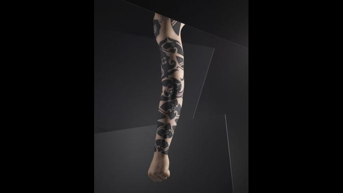 Silicone male arm with tattoo design by Ernesto Kalum, Borneo. (Courtesy of The Field Museum)