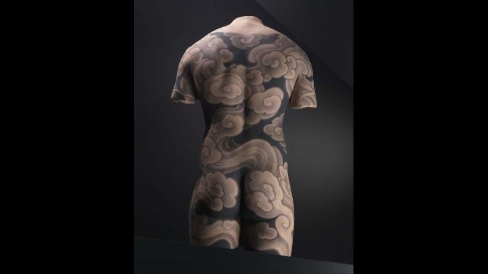 Silicone male back with tattoo design by Filip Leu, Switzerland. (Courtesy of The Field Museum)