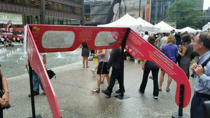 Solar glasses display and giveaway at Daley Plaza on Aug. 17. ( Al Hilliard / Chicago Tonight)