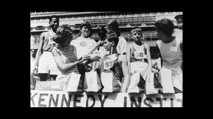 Eunice Kennedy Shriver, left, stands with athletes. She served as director of the Joseph P. Kennedy Foundation, which helped fund the event.  (Courtesy of Special Olympics Chicago)