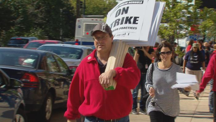 CPS teachers picked up strike materials such as shirts and signs at CTU headquarters Monday in preparation for a possible strike Tuesday morning.