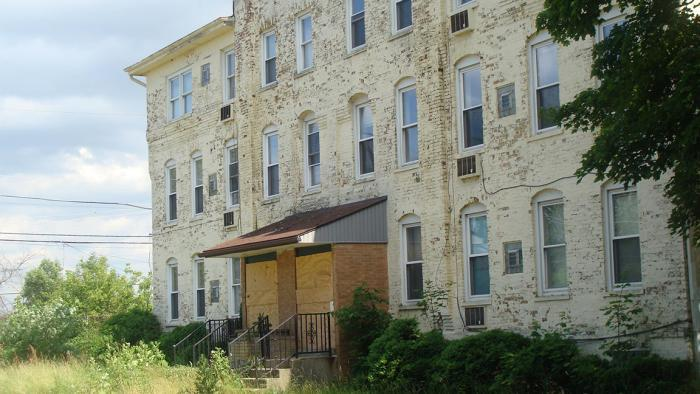 One of two tenement buildings that will be rehabilitated as part of a plan to build lofts in historic Pullman. (Mark Cassello)