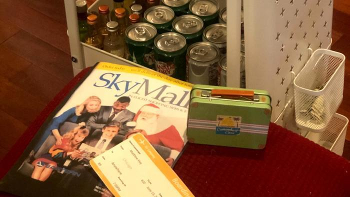 Theme night is all about the details, like faux boarding passes, Sky Mall magazines and an improvised beverage cart. (Courtesy of Heather Payne)