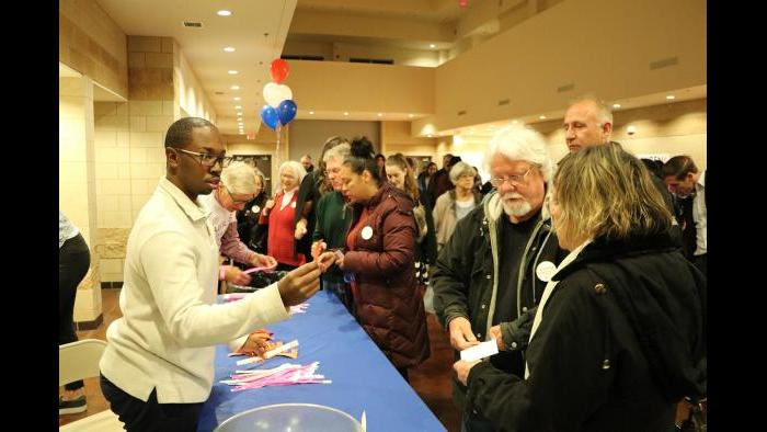 Attendees arrive at the election night event for Lauren Underwood, the Democratic candidate running in Illinois' 14th Congressional Illinois District. (Evan Garcia / Chicago Tonight)