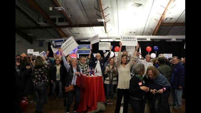 Attendees wave signs, preparing for Underwood to reach the stage for her victory speech. (Evan Garcia / Chicago Tonight)