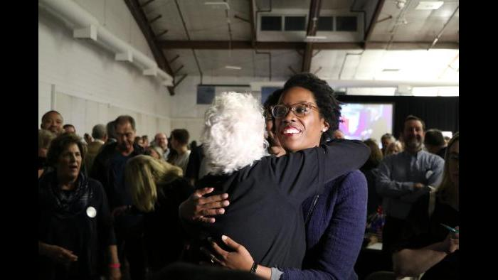Democratic candidate Lauren Underwood makes her way through the crowd of supporters. (Evan Garcia / Chicago Tonight)