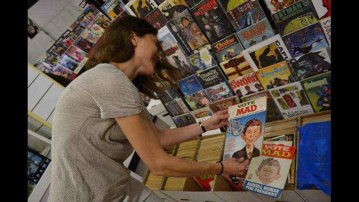 West Rogers Park resident Lisa DiChiera picks up some issues of MAD Magazine at Variety Comics. (Photo/Kristen Thometz)