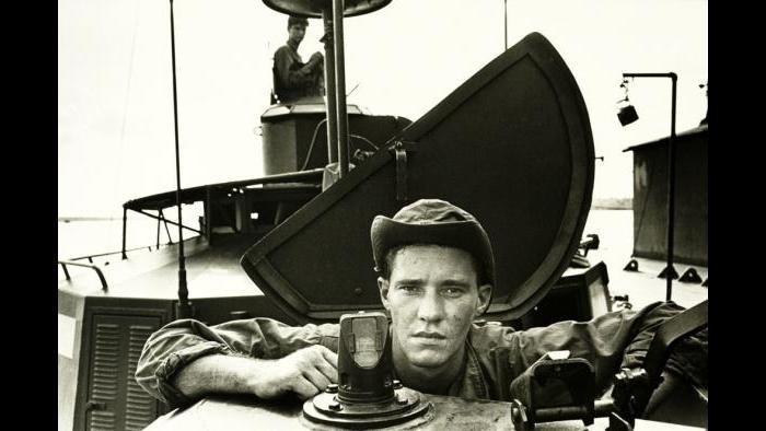 "River Rat, 1967. A crew member participates in Operation Coronado on a Heavy Support Boat (Monitor) in the Rung Sat Special Zone (""Killer Swamp""), southwest of Saigon in Biên Hòa Province. Photo by Specialist 5 Richard A. ""Dick"" Durrance, U.S. Army."