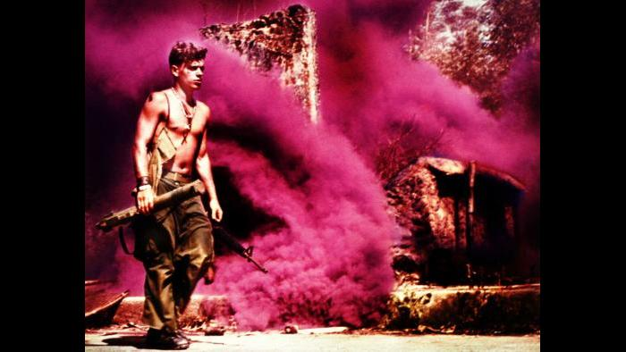 Rootin' Tootin' Raspberry, 1969. A member of the U.S. Army 101st Airborne Division sets smoke for a helicopter extraction near Tam Kỳ in the Quảng Tín Province. Photo by Captain Roger Hawkins, U.S. Army.