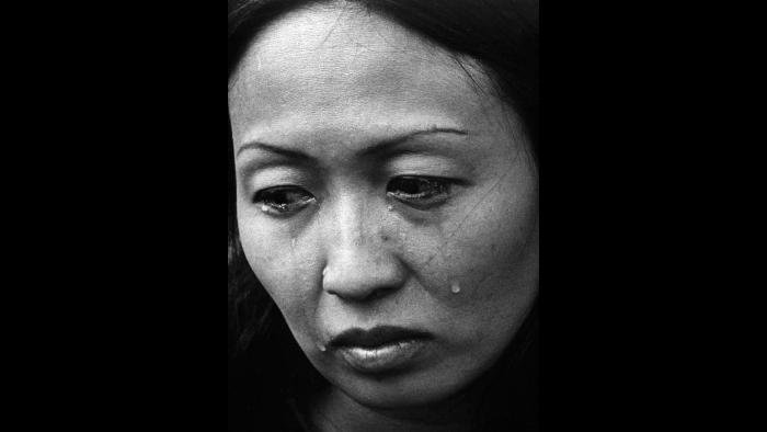 Refugee, 1975. A South Vietnamese refugee cries upon her arrival at Eglin Air Force Base near Valparaiso, Florida. Photo by Specialist 5 Bryan K. Grigsby.