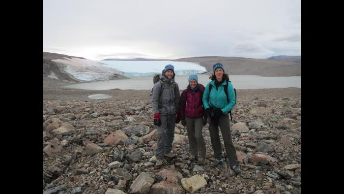 Northwestern Ph.D. students stand with Yarrow Axford in front of a glacier in Northwest Greenland near the Thule Air Base in August 2014. (Photo by Alex P. Taylor)