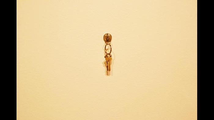 A copy of the apartment keys hung upon hardware at the Weinberg/Newton Gallery. (Maya Miller / Chicago Tonight)