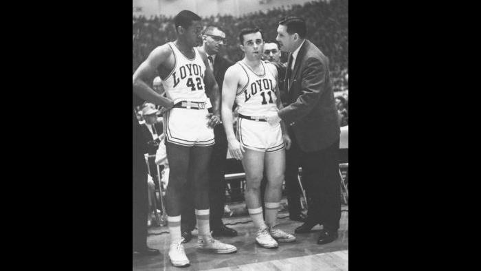 Loyola coach George Ireland talks to Ron Miller, left, and Johnny Eagan during 1963 game.