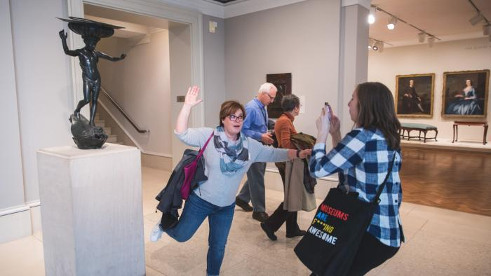 Guests imitate a sculpture on a Museum Hack tour. (Courtesy of Museum Hack)