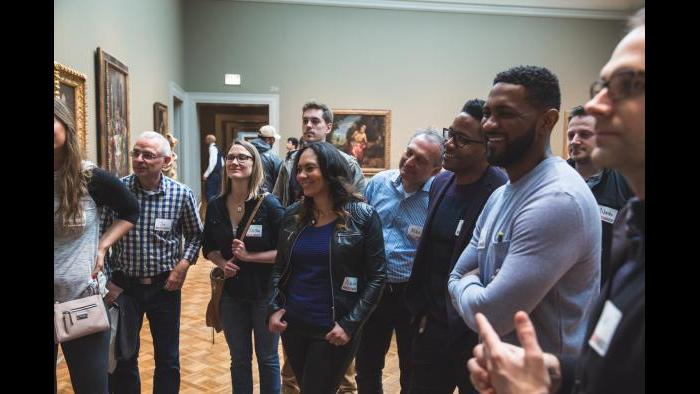 FitzGerald Associates Architects staff smile as they hear about a piece at the Art Institute while on a Museum Hack tour. (Courtesy of Museum Hack)