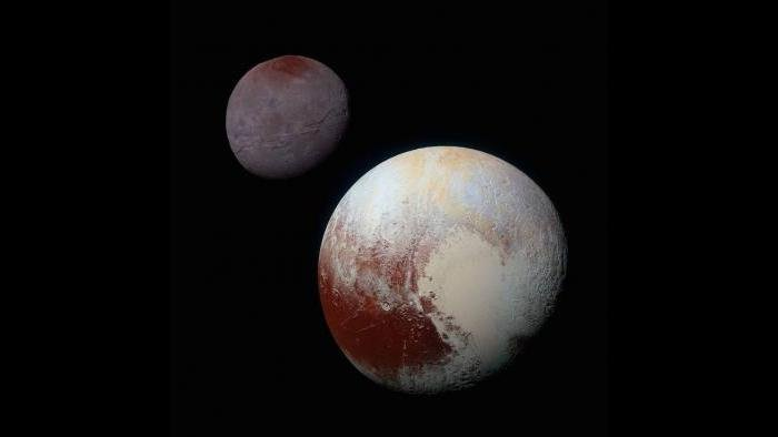 Pluto (lower right) and its moon Charon (upper left) (Courtesy of NASA/JHUAPL/SwRI)